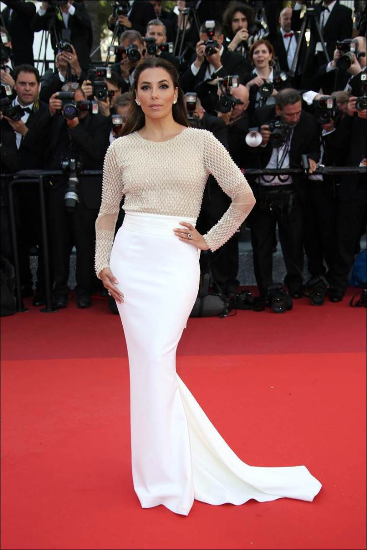 Actress Eva Longoria arrives on the red carpet for the screening of the film Cafe Society and the Opening Ceremony at the 69th international film festival, Cannes, southern France, Wednesday, May 11, 2016. (AP Photo/Joel Ryan)
